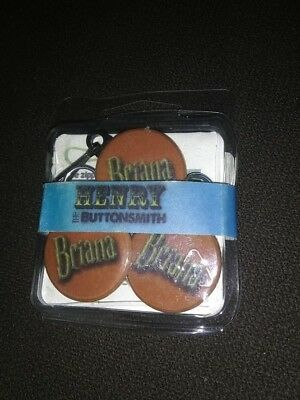 BRIANA or ISAIAH  3 piece set ID Bag Tag and 2 buttons - New and in package