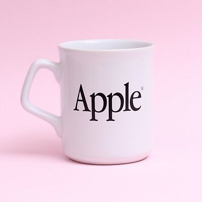White Apple Computer Mug with Black Apple Logos on Both Sides