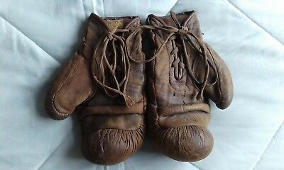 A pair of Frank Bryan Ltd of London vintage leather boxing gloves, 30's era