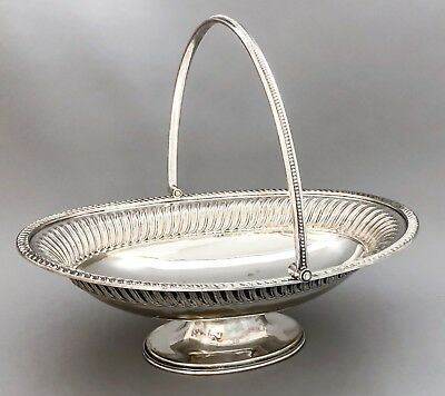 Antique silver plate oval pedestal fruit bowl swing handle basket embossed reed