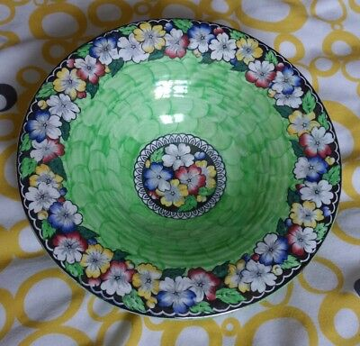 Maling pansy pattern bowl . Green thumbprint pattern on the outside and inside