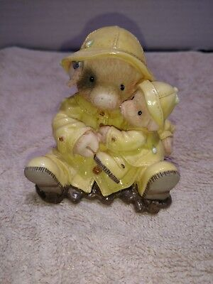 Tlp Enesco This Little Piggy Showering You With Hogs. Yellow Raincoat With Baby