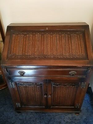 Old charm dark oak bureaux with writing desk pidgeon holes and cupboard
