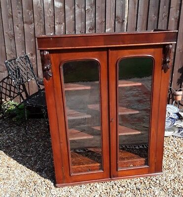 beautiful antique mahogany bookcase with intergrated drawers glass doors