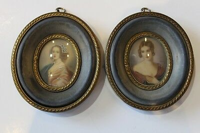 Pair of antique miniature portraits. Late 19th Century. In ornate brass frames.