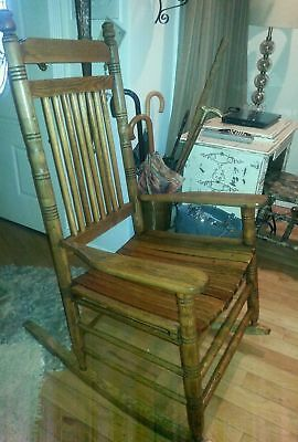 Antique vintage solid wood larger rocking chair