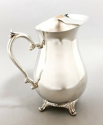 Vintage silver plate water pitcher big jug cast scroll base ice guard WM Rogers