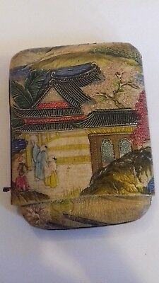 Antique Japanese tooled and coloured leather purse