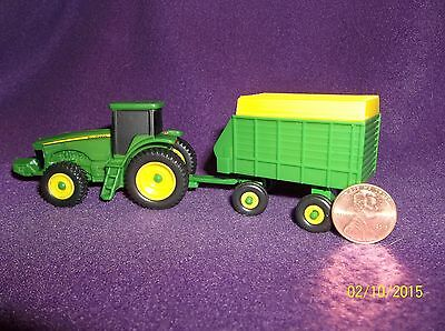 Ertl: 1/64 John Deere tractor and implement. Loose but never used. New condition