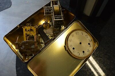 Assorted clock movements and parts, one with chimes
