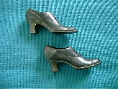 A pair of Antique/Vintage Ornamental Metal Shoes or low boots