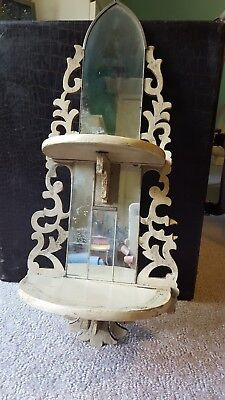 Carved wood folding curio shelf.  2 shelves.  Mirrored.  Made in Japan. Vintage