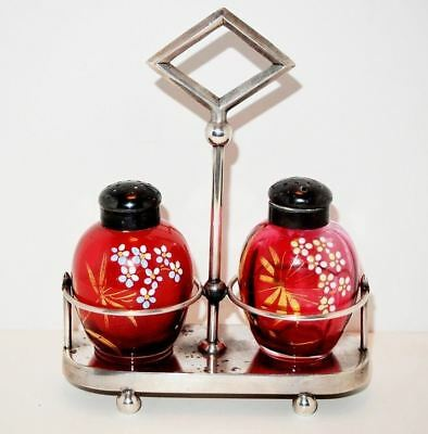 Matching Hand Painted Cranberry Salt And Pepper Shakers In Silver Plate Stand