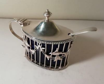 A Large Ornately Decorated Silver Mustard Pot & Blue Glass Liner : London 1925