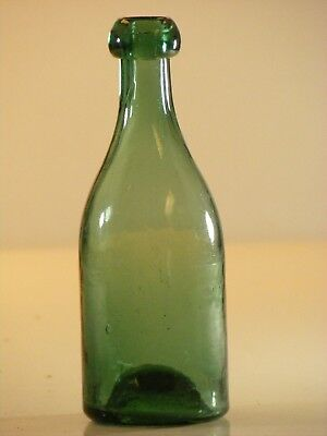 Green Iron pontil soda, mineral water, ale or stout with a semi donut blob