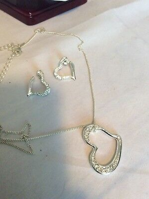 Avon necklace and earring set- silver heart set