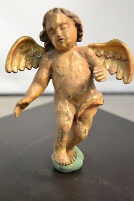 a pair of 17th c. fragmentary carved wooden 'putti' figures