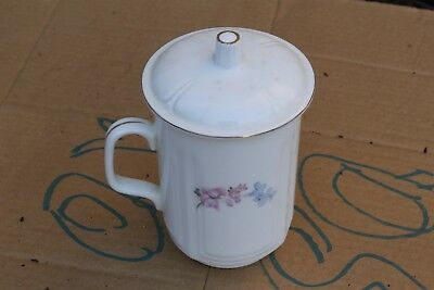 Old Chinese or Japanese snow white porcelain tea cup, marked