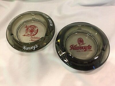 "Two HARVEY'S CASINO, LAKE TAHOE NV, VINTAGE ASHTRAYS, 4.25"" SMOKED Gray glass"