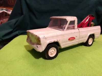 old toy antique vintage Tonka 1960sjeep cherokee tow truck as is