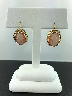 Lady's antique cameo dangle earrings, made of 14k yellow gold