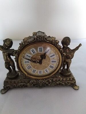 Vintage Splendex Brass Mantle Clock with two cherub playing Lute and Viola.
