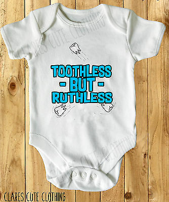 TOOTHLESS BUT RUTHLESS CUTE blue BABY VEST/ GROW WHITE all sizes available