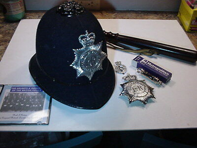 English Bobby helmet, medal, whistle and nightstick