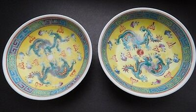 Pair Chinese round small dishes with yellow ground with 5 toed dragons & Carp