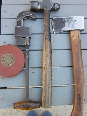Old tools, tape measure, axe, hammer, pipe cutter