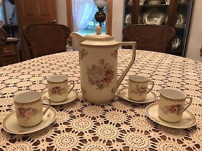 Antique China Chocolate Pot & Four Dematasse Cups And Saucers. ..germany