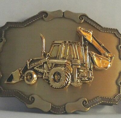 2 Vintage Case Belt Buckles Backhoe 508B and a Eagle on the Earth Raintree & W