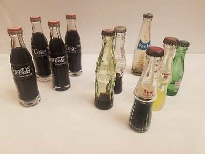 Lot of 10 vintage miniature coke cola/fanta/canada dry/spur cola soda bottles