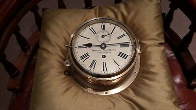 Brass fusee ships clock. .marked Thomas  Armstrong. .Liverpool
