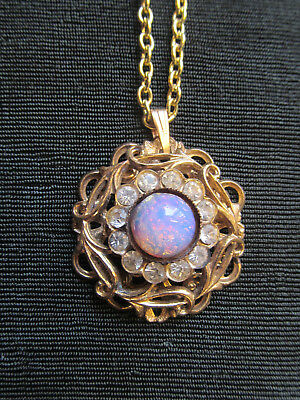 Vintage gold tone Faux Opal and rhinestone pendant with chain.