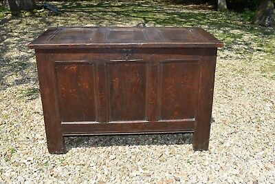 An early 18th century oak panelled coffer/chest