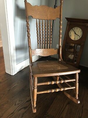 Antique Pressed Back Oak Rocking Chair With Cane Seat 8 Spindles