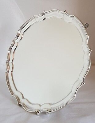 A Sterling silver Salver .Decorative Chippendale style border. Birmingham 1966