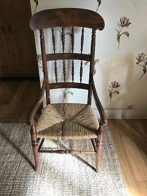 Oak,high back, rush seat antique bobbin chair