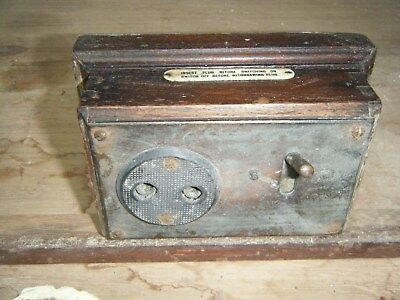 antique electric socket. wooden case metal front used condition