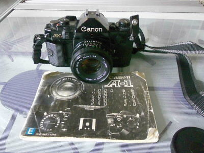Canon A-1 35mm SLR Camera with Canon Lens FD 50mm 1: 1.8 Lens and manual
