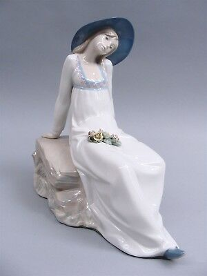 """Lladro """"Reclining Gire With Flowers"""" Porcelain Figurine"""