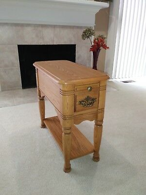 """Beautiful solid oak end table. 25"""" L x 12"""" W x 23"""" H with drawer."""