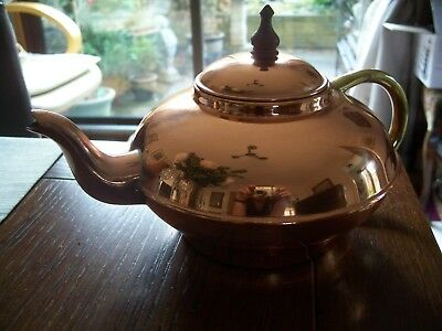 Vintage Copper Teapot with wooden knob and brass handle.