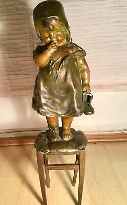 1890's American bronze statuette - Little girl standing on stool holding a shoe