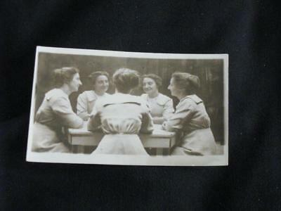 RPPC -Manipulated, composite photo card. Woman with 4 clones of herself.