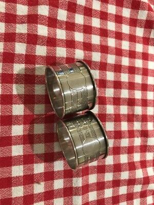 Two solid silver napkin rings