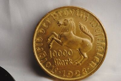 1923 10,000 Mark Notgeld coin in extra fine.  Coin is size of crown
