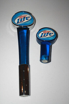 Two Miller Lite Tap Handles.