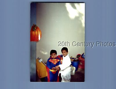 Found Color Photo P+0928 Boys In Halloween Costumes As Superman And Karate Kid